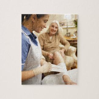 Nurse wrapping bandage on senior woman's leg to jigsaw puzzle