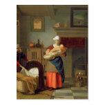 Nursemaid con el bebé en un interior postal