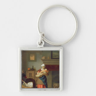 Nursemaid with baby in an interior keychain