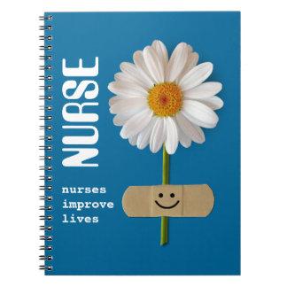 Nurses improve lives. Gift Notebook