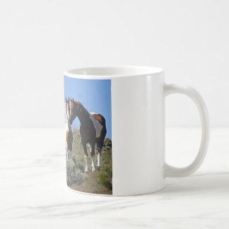 Nuzzling horses coffee mug