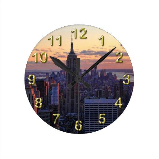 NYC Skyline just before sunset Round Wall Clock