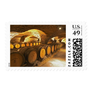 Oak barrles in the cellar at Domaine Comte Postage