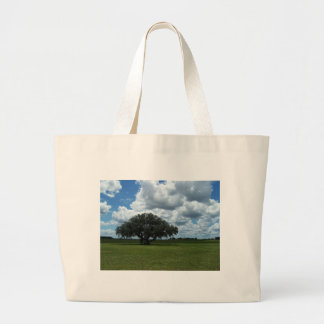 Oak Tree and Clouds Tote Bags