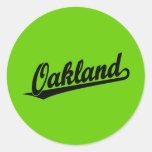 Oakland script logo in black classic round sticker