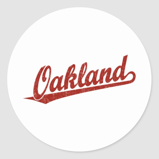 Oakland script logo in red distressed round stickers