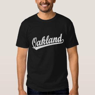 Oakland script logo in white shirt