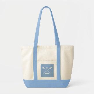 Oar inspiring slogan and crossed oars light blue tote bag
