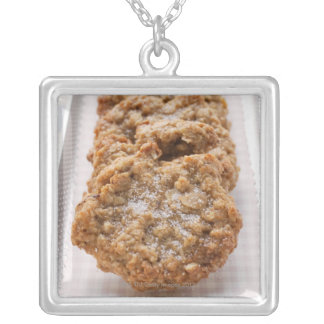 Oat biscuits on plate silver plated necklace