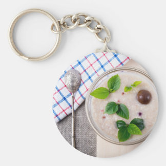 Oatmeal with chocolate candy and a silver spoon keychain