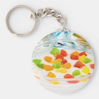 Oatmeal with colorful candied fruits in a glass keychain