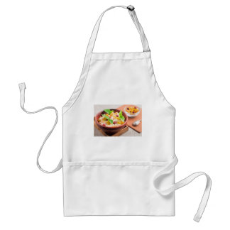Oatmeal with raisins and berries in a wooden bowl adult apron