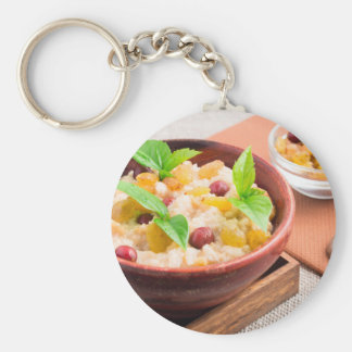 Oatmeal with raisins and berries in a wooden bowl keychain