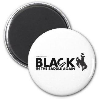 Obama 2012, negro en la silla de montar otra vez imán redondo 5 cm