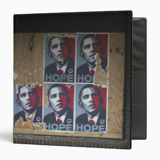 Obama signs in a boarded window of a closed binder