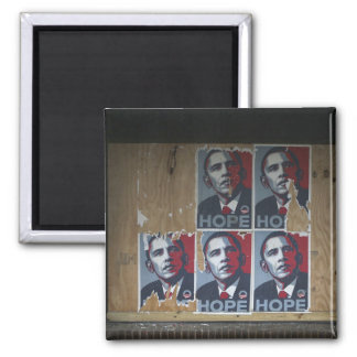 Obama signs in a boarded window of a closed magnet