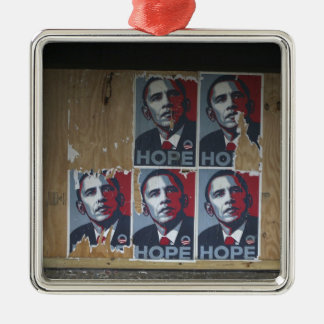 Obama signs in a boarded window of a closed metal ornament