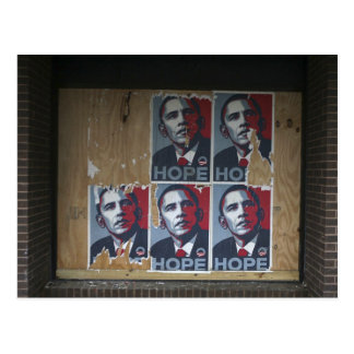 Obama signs in a boarded window of a closed postcard