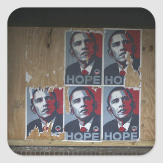 Obama signs in a boarded window of a closed square stickers