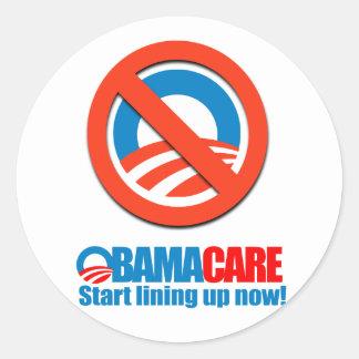 Obamacare - Start lining up now Round Sticker