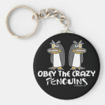 Obedezca los llaveros locos de los pingüinos