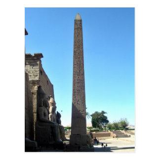 Obelisk in luxor temple against blue sky postcard