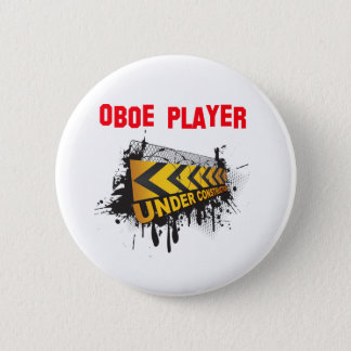 Oboe player under construction button