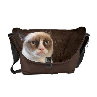 Obra clásica gruñona del gato bolsas de mensajería