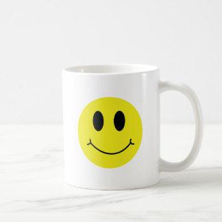 Obra clásica sonriente de la cara taza