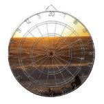 Observación de la puesta del sol tablero dardos