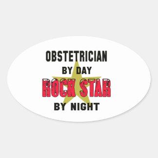 Obstétrico por el día rockstar por noche pegatina ovalada