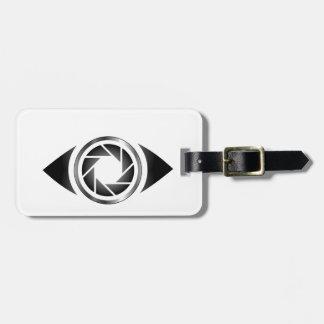 Obturador de la fotografía en un ojo etiquetas maleta