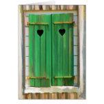 Obturadores verdes del cortijo con los corazones tarjetas