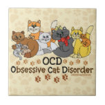 """OCD Obsessive Cat Disorder Tile<br><div class=""""desc"""">OCD Obsessive Cat Disorder funny cat lovers saying design with 10 cats in different colors. Funny cat spoof / parody to obsessive compulsive disorder. Do they call you the crazy cat lady? Or know anyone who is or could be?</div>"""