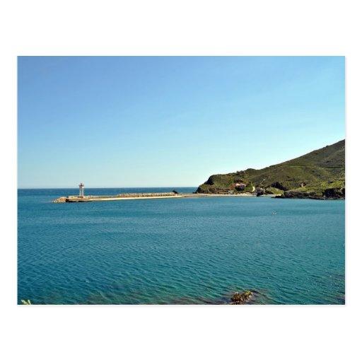 Ocean against blue sky postcard