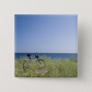Ocean and horizon with clear blue sky pinback button