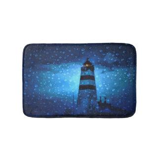 Ocean lighthouse a dark blue night with drops bathroom mat