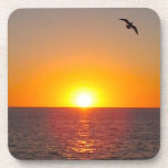 "Ocean Sunset Coaster Set<br><div class=""desc"">Beautiful sunset captured over the ocean,  while a gull flies overhead makes this coaster set a great gift for men,  ocean,  nature lovers and more!</div>"