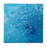 "Ocean Under - Abstract Blue Bubbles Ceramic Tile<br><div class=""desc"">&quot;Ocean Under&quot; is the title of this fine art abstract photograph,  featuring air bubbles frozen just under the surface of aqua blue ice. &#169;Shannon Workman</div>"