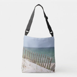 Ocean view through the beach fence crossbody bag