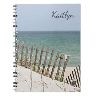 Ocean view through the beach fence notebook