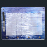 """Ocean Waves Calendar Dry Erase Board<br><div class=""""desc"""">The dry erase board features a photograph of the beautiful blue ocean behind a blank calendar to be customized by you! Use the included pen each month to write the month&#39;s name at the board&#39;s top, number the days and jot notes on what needs to be done. You may change...</div>"""