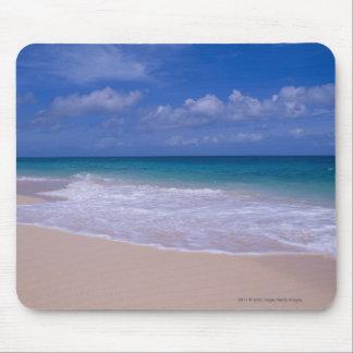 Ocean waves foaming onto sandy beach mouse pad