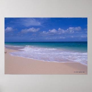 Ocean waves foaming onto sandy beach poster