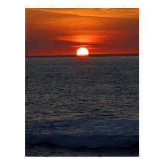 Océano de la puesta del sol postales