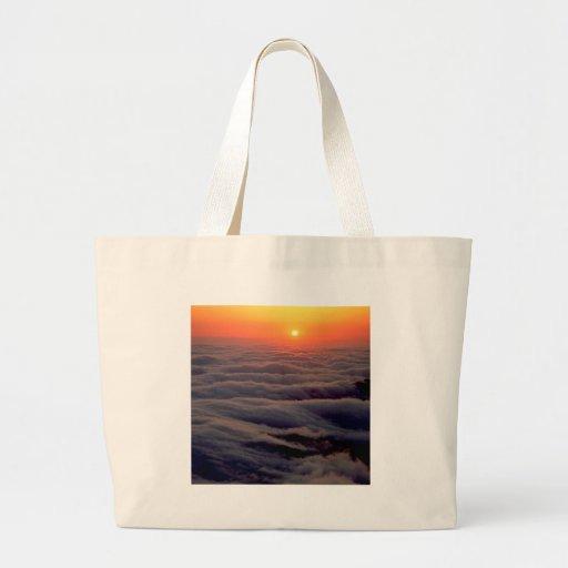 Océano nublado de la puesta del sol bolsas lienzo