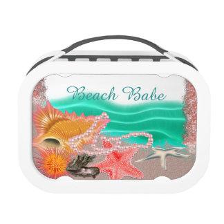 Océano y Seashells del bebé de la playa