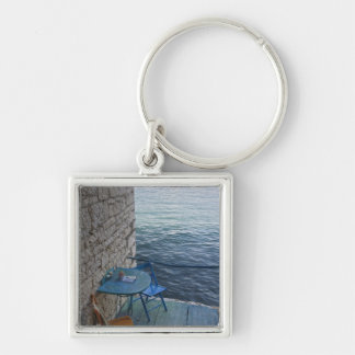 Oceanside seating for two at tiny outdoor cafe, Silver-Colored square keychain
