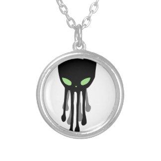Octokitten es un gatito negro agradable kraken. colgante redondo