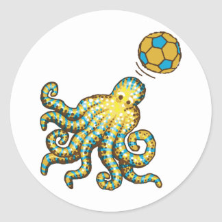 Octopus with a soccer ball classic round sticker